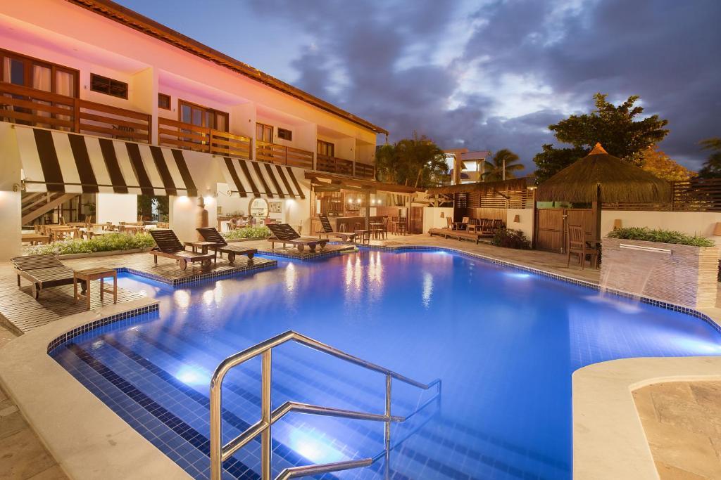 A piscina localizada em Pousada Quatro Estações ou nos arredores