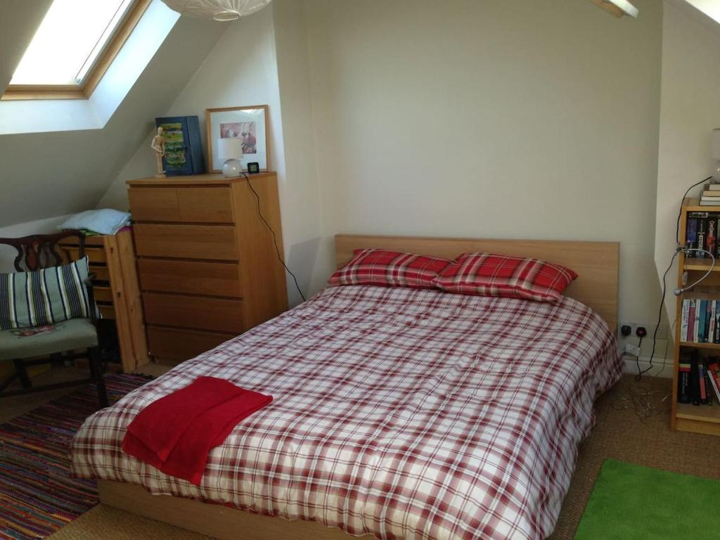 A bed or beds in a room at Fishponds Retreat Homestay
