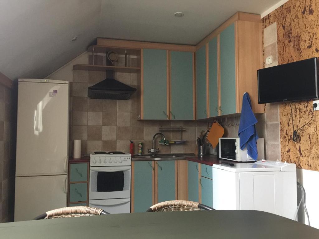 Кухня или мини-кухня в Апартаменты Усадьба Бюргера