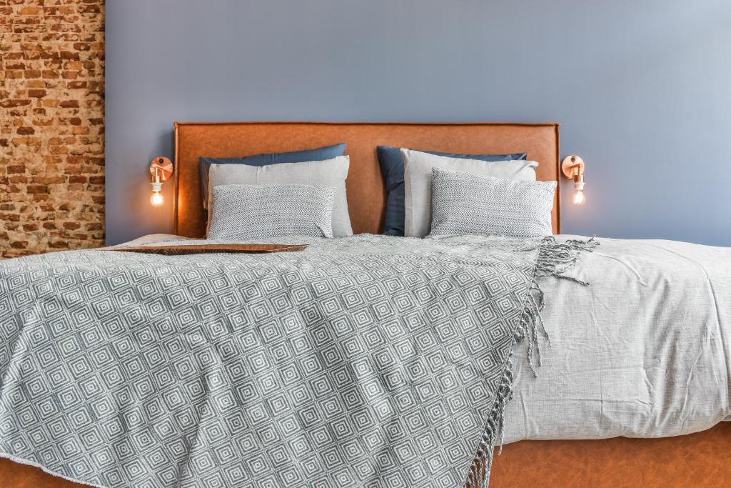 Een bed of bedden in een kamer bij Boutique Hotel Koninginn