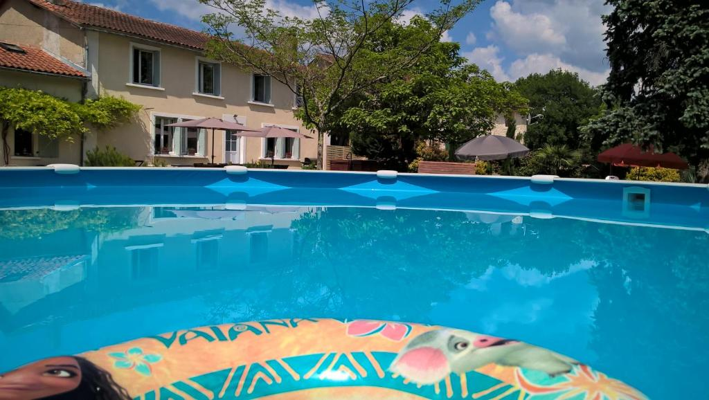 The swimming pool at or near 'La Maison Catalpa' French Farmhouse with Pool & Jaccuzi
