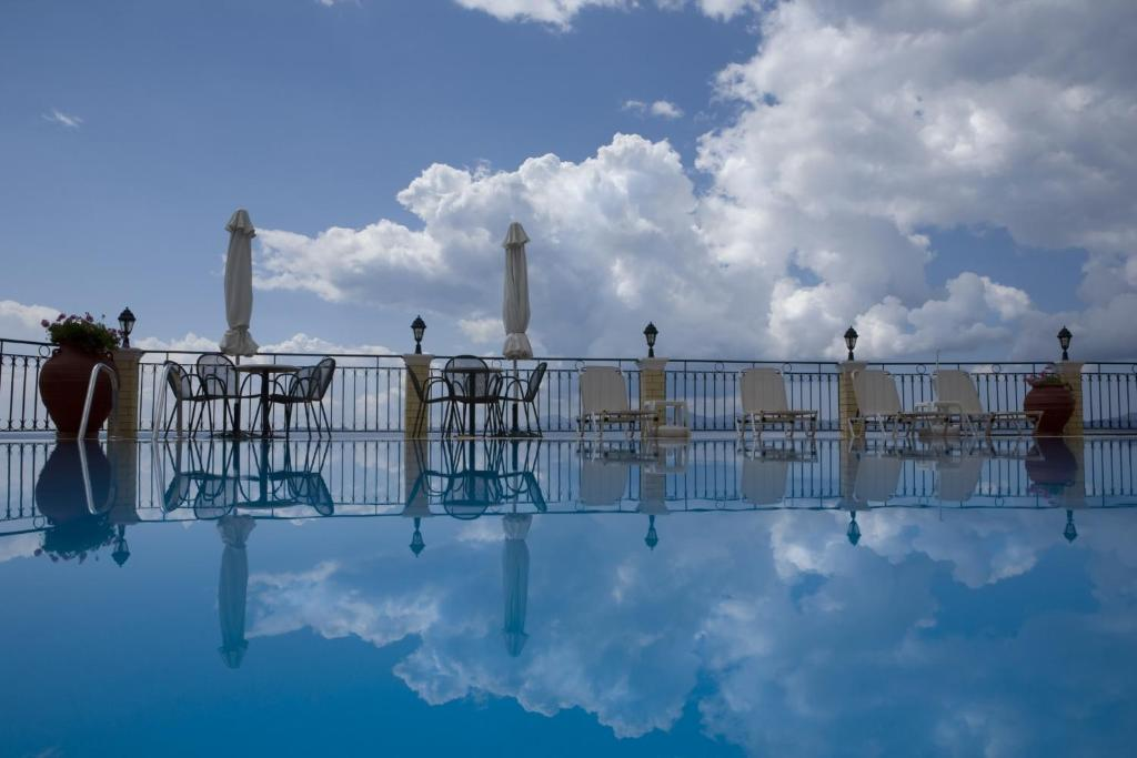 The swimming pool at or near Oceanis Rooms Apartments