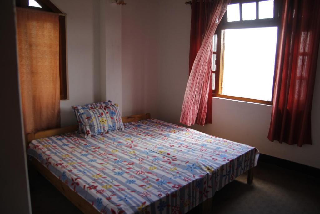 A bed or beds in a room at Vamoose Mahimalaya