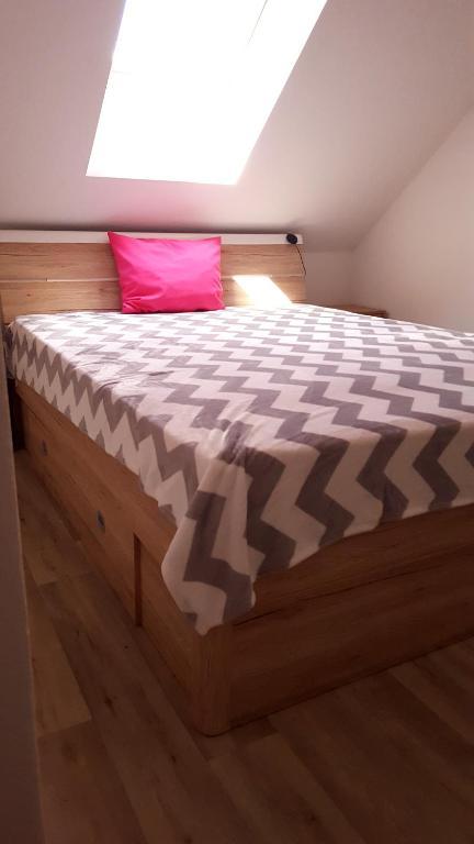 Кровать или кровати в номере Penzion Malaika