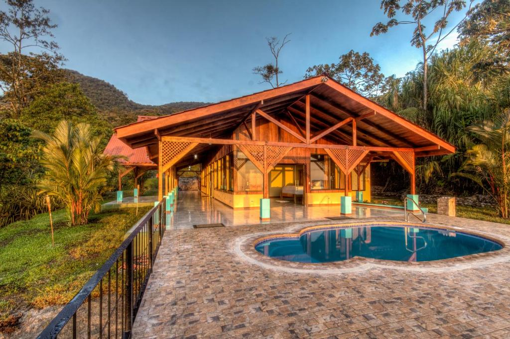 The swimming pool at or near Arenal Waterfall Lodge