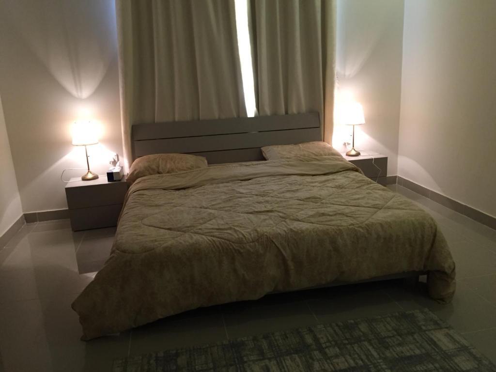 سرير أو أسرّة في غرفة في The Diamonds (Families Only )
