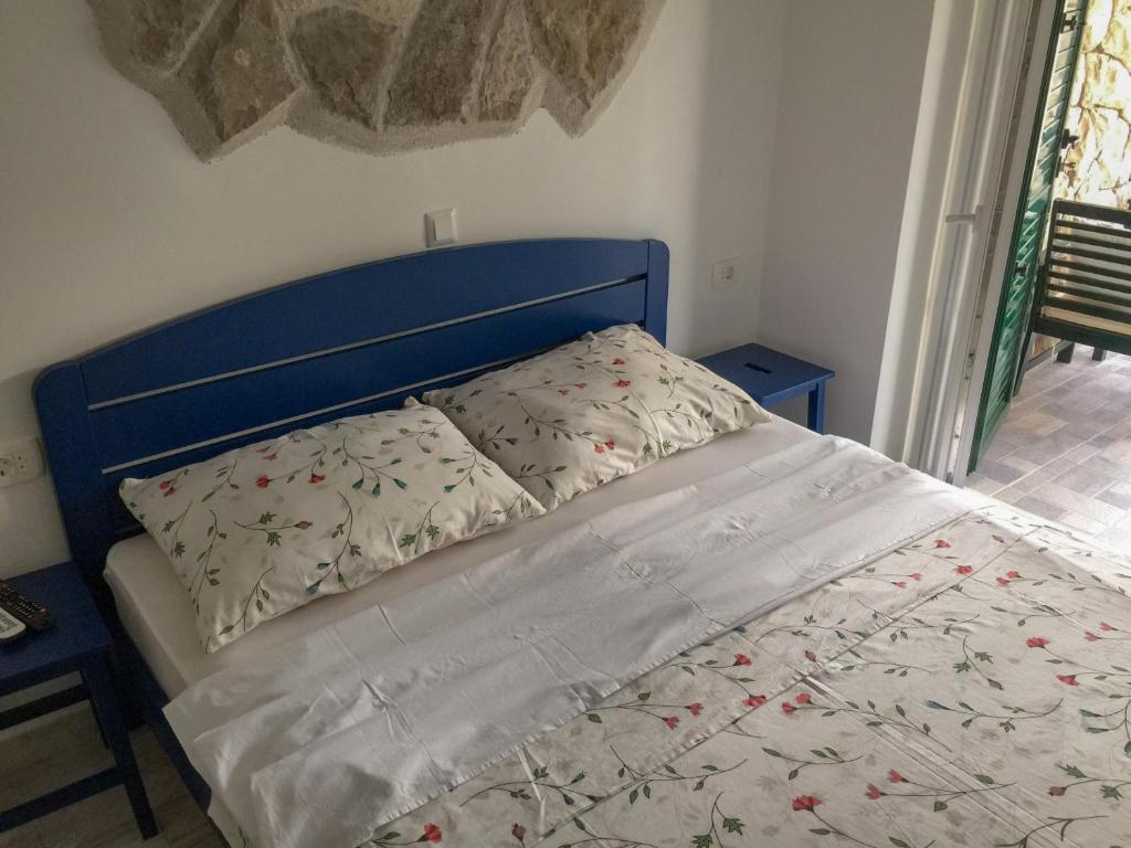 A bed or beds in a room at Apartments Pomeštak
