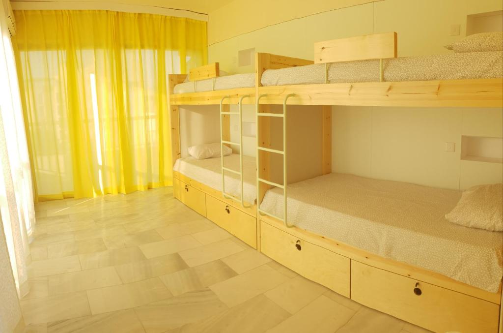 A bunk bed or bunk beds in a room at NEX Hostel