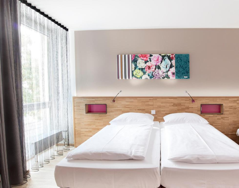 A bed or beds in a room at fab Hotel
