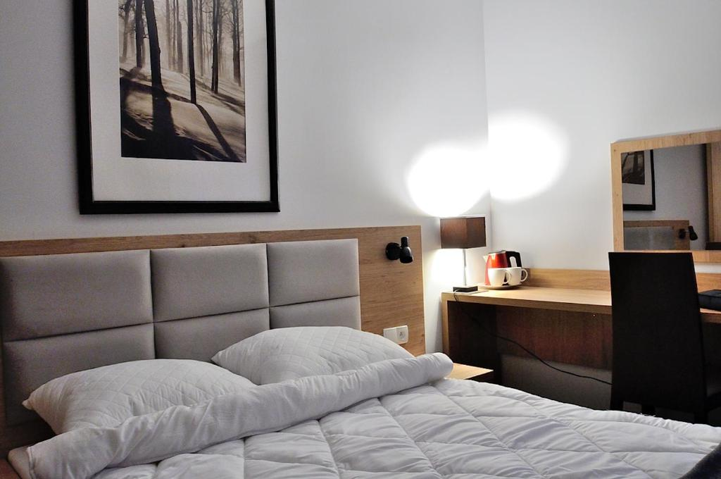 A bed or beds in a room at Willa Centrum