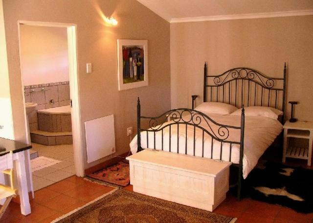 A bed or beds in a room at Rose Garden Manor House