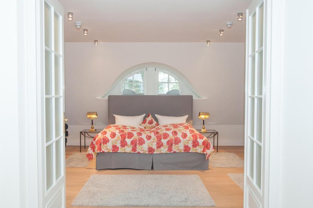 Ein Bett oder Betten in einem Zimmer der Unterkunft Landhaus Töpferhof