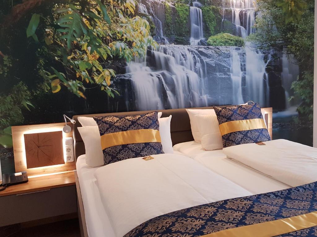 Ein Bett oder Betten in einem Zimmer der Unterkunft PRIMA Hotel Harzromantik