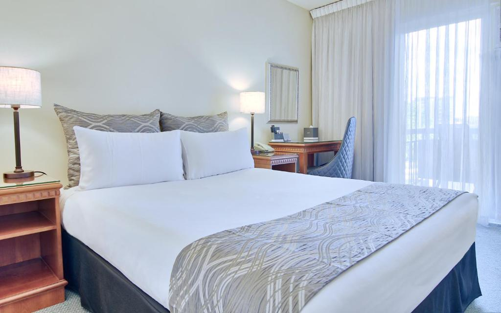 A bed or beds in a room at Soho Brisbane