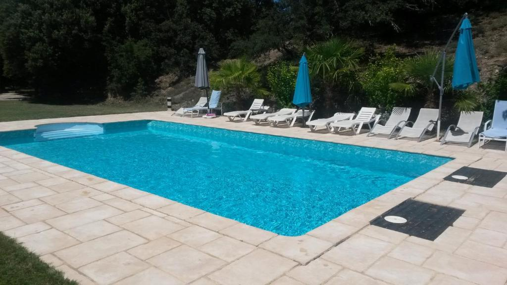 The swimming pool at or near Ferme de Palumiane