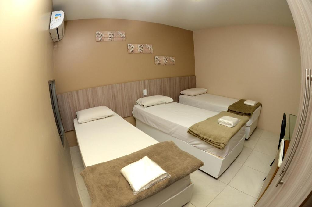 A bed or beds in a room at Hotel Itaparica