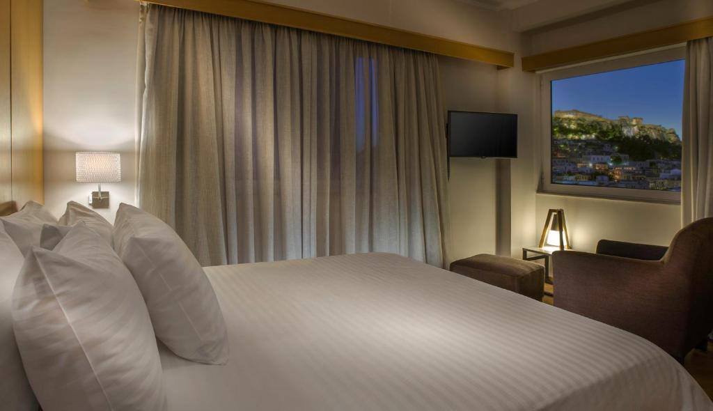 A bed or beds in a room at Acropolis View Penthouse