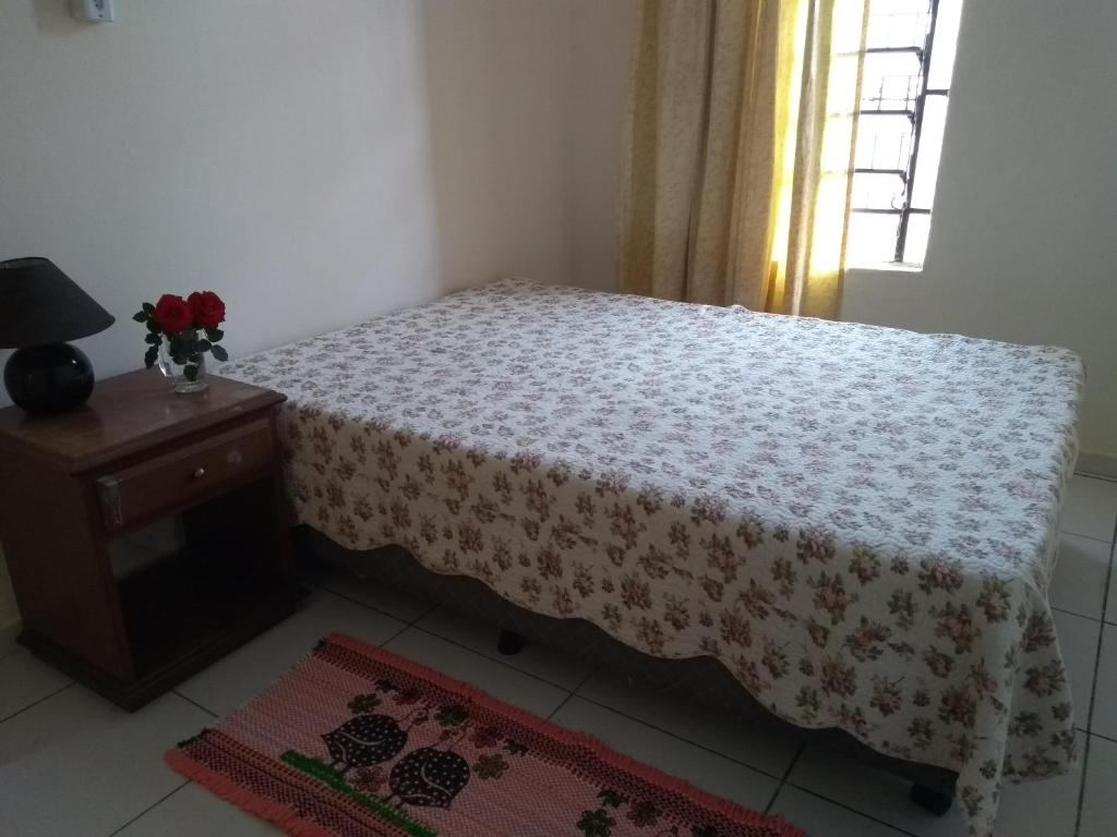 A bed or beds in a room at Celia Guest House