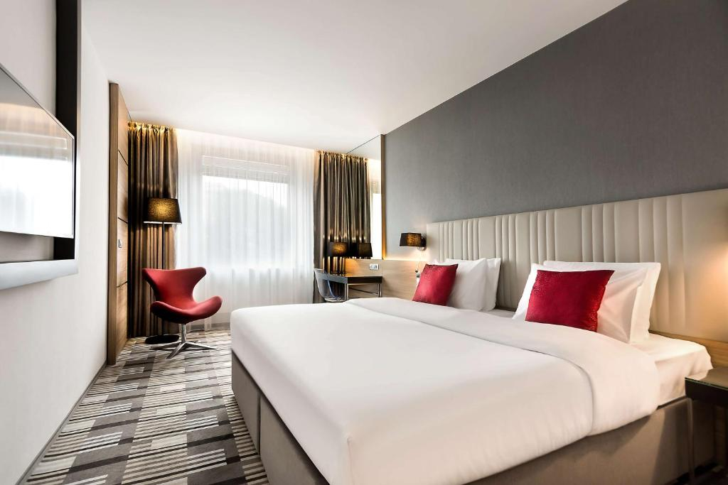 A bed or beds in a room at Best Western Premier Hotel International Brno