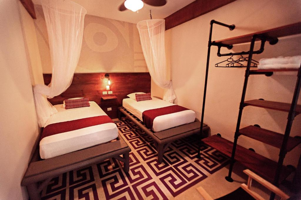 A bed or beds in a room at Jungle Lodge Tikal Hostal