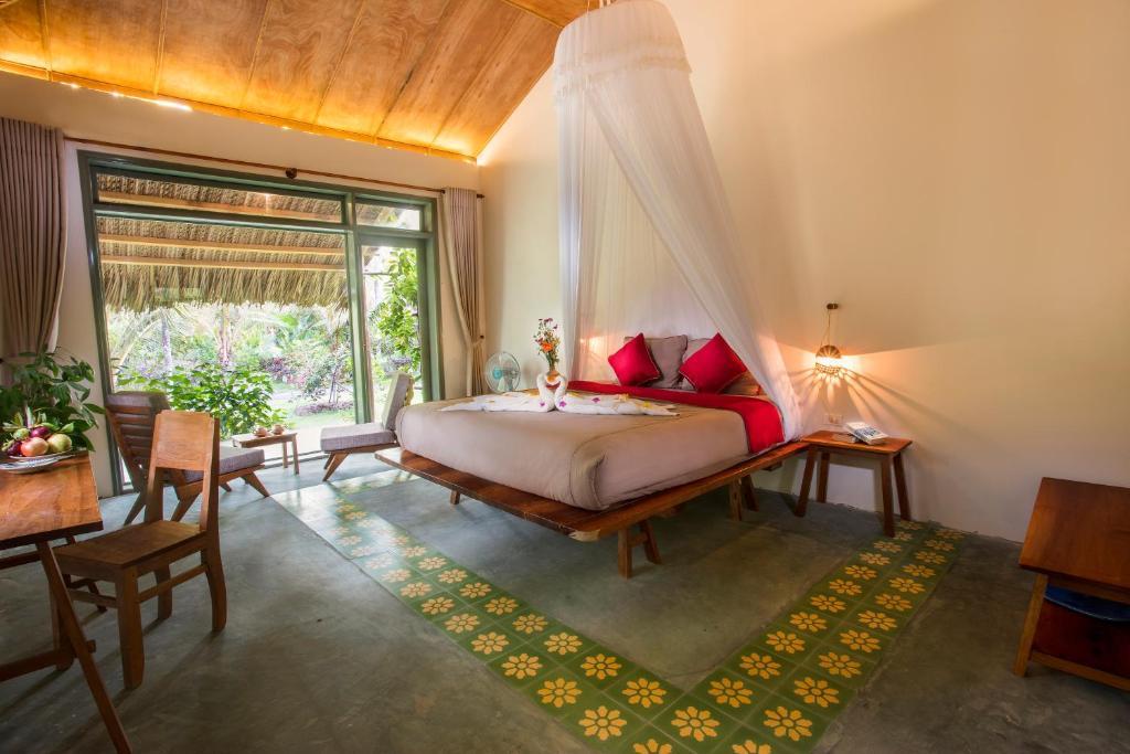 Giường trong phòng chung tại Mekong Home