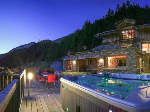 The swimming pool at or near Le Chalet des Anges
