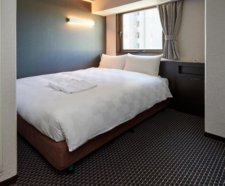 A bed or beds in a room at Hotel Consort