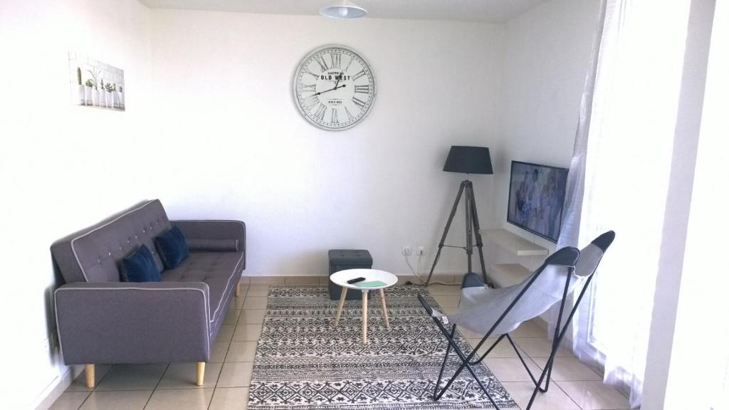 A seating area at Appartement Mango - Baie-Mahault