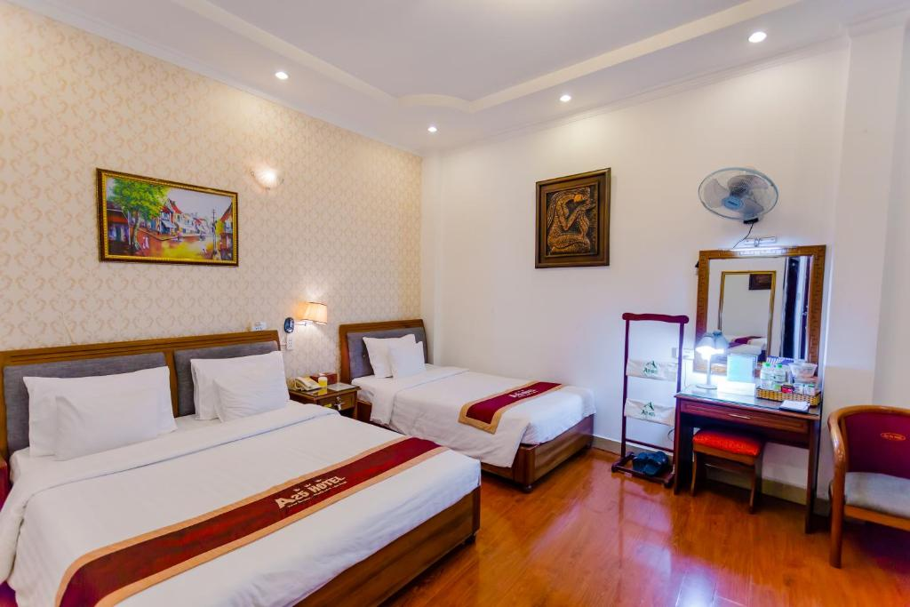 A bed or beds in a room at A25 Hotel - 122 Lê Lai