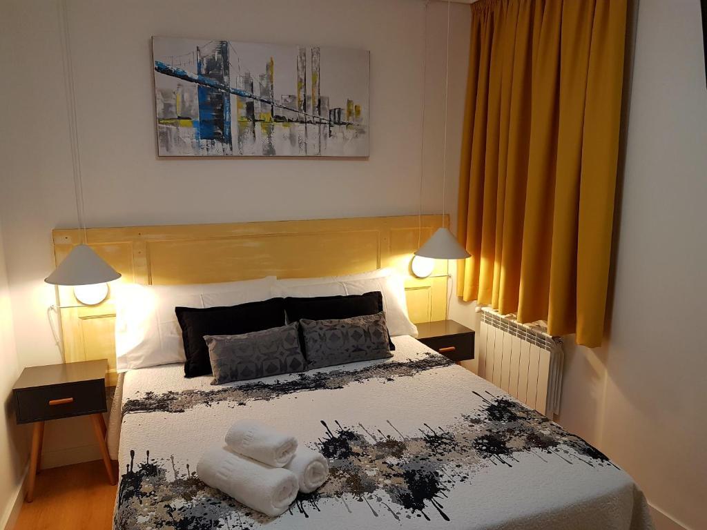 Cama o camas de una habitación en Pensión Sotelo