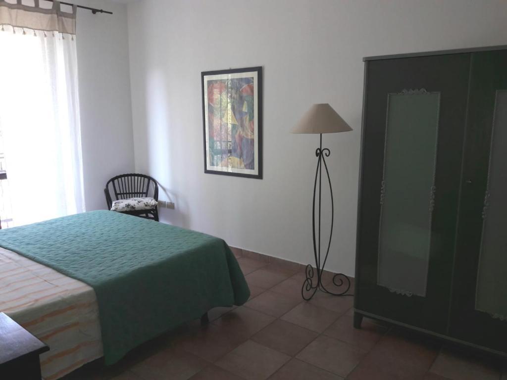 Letto o letti in una camera di Apartment San Filippo