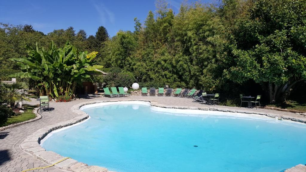 The swimming pool at or near Au Faisan Doré