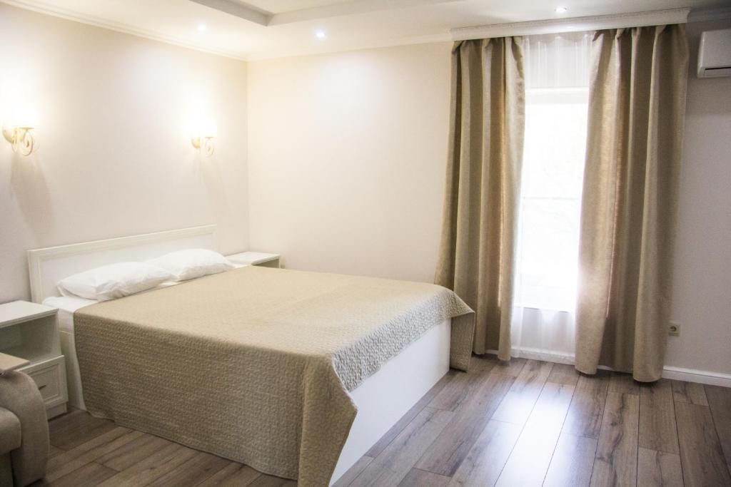 Кровать или кровати в номере Апартаменты на Виноградной
