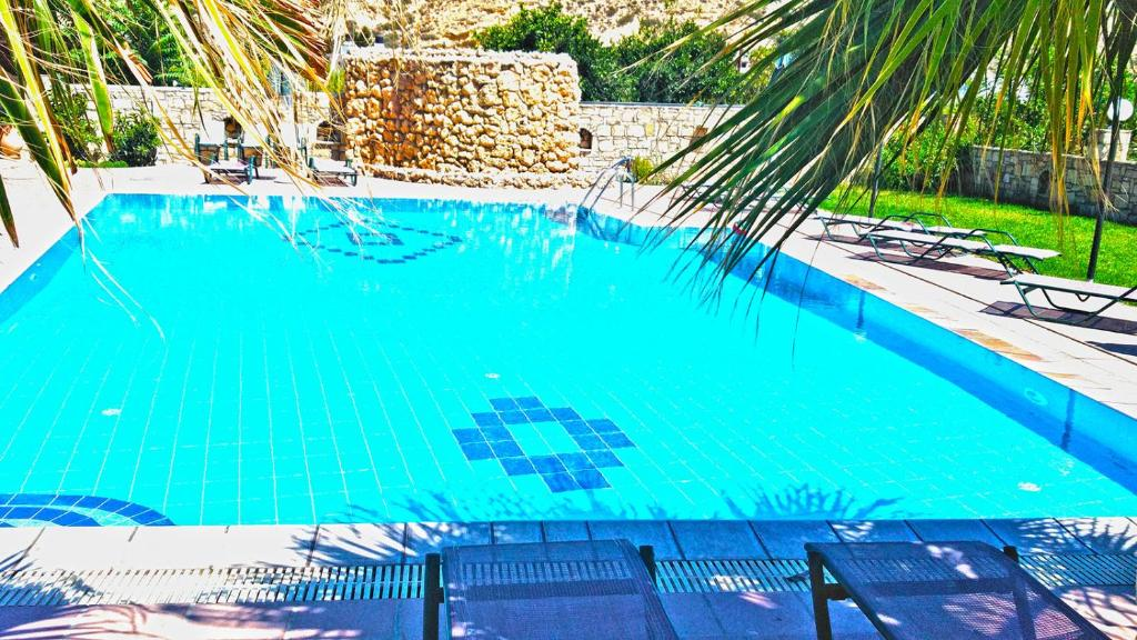 A view of the pool at Dimitris Villa Hotel or nearby