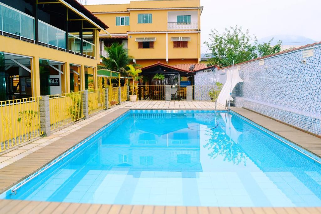 The swimming pool at or near Pousada H&D