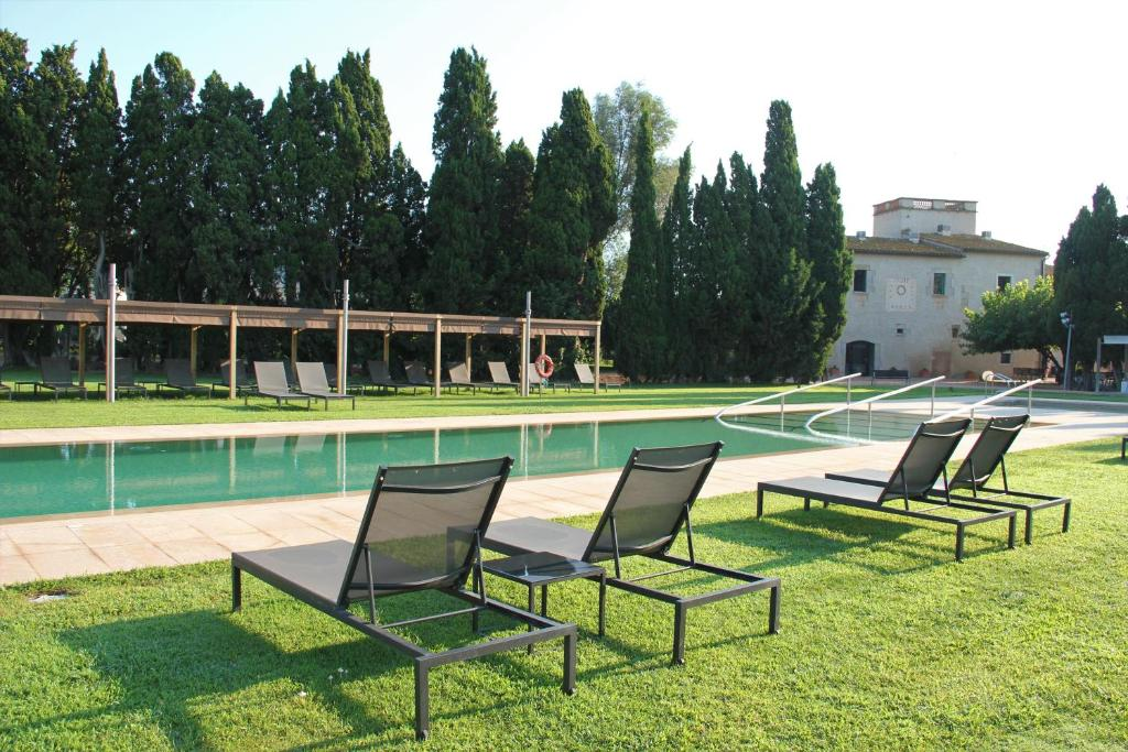 The swimming pool at or near URH - Hotel Molí del Mig