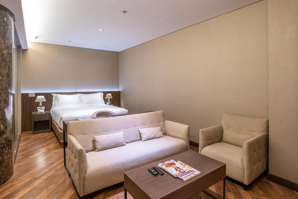 A bed or beds in a room at Ashley Wahid Hasyim Jakarta