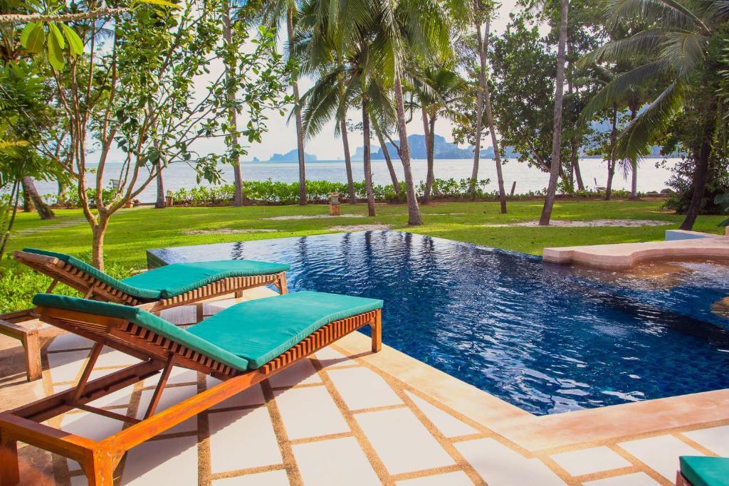 The swimming pool at or near Amatapura Beachfront Villa 12, SHA Certified