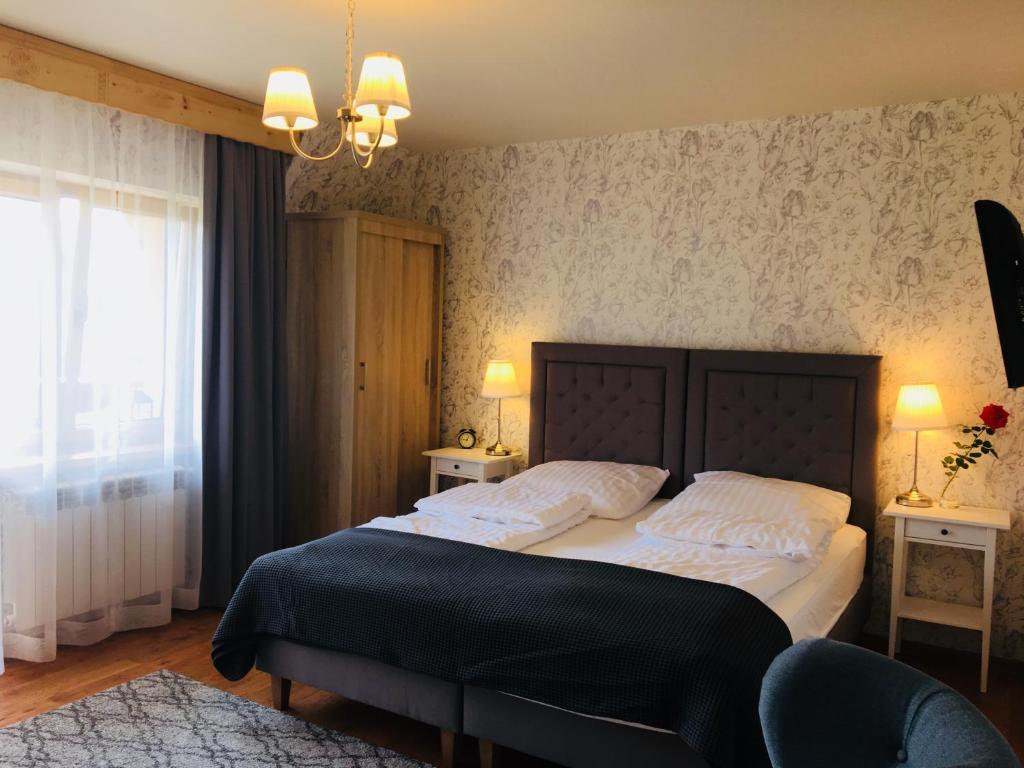 Łóżko lub łóżka w pokoju w obiekcie Apartamenty w Jurgowie Świstokówka