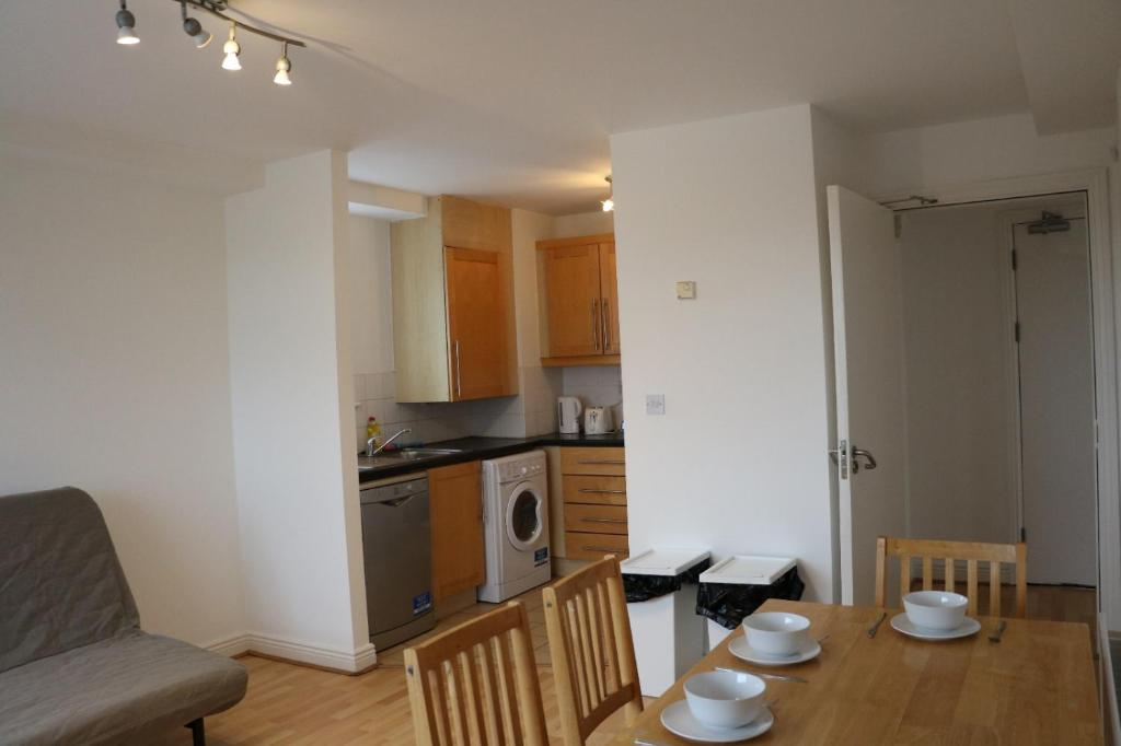 A kitchen or kitchenette at The Sentinel Tower Airport Apartments