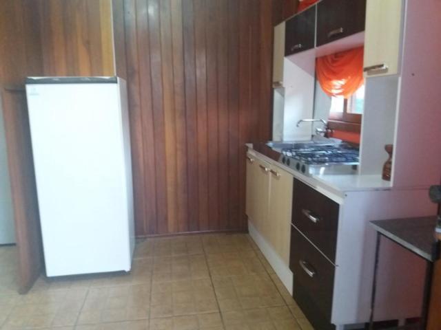 A kitchen or kitchenette at Apartamento Dois