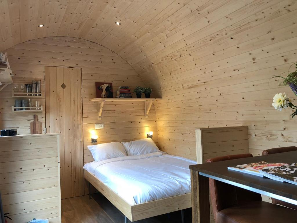 A bed or beds in a room at Little Lighthouse Texel