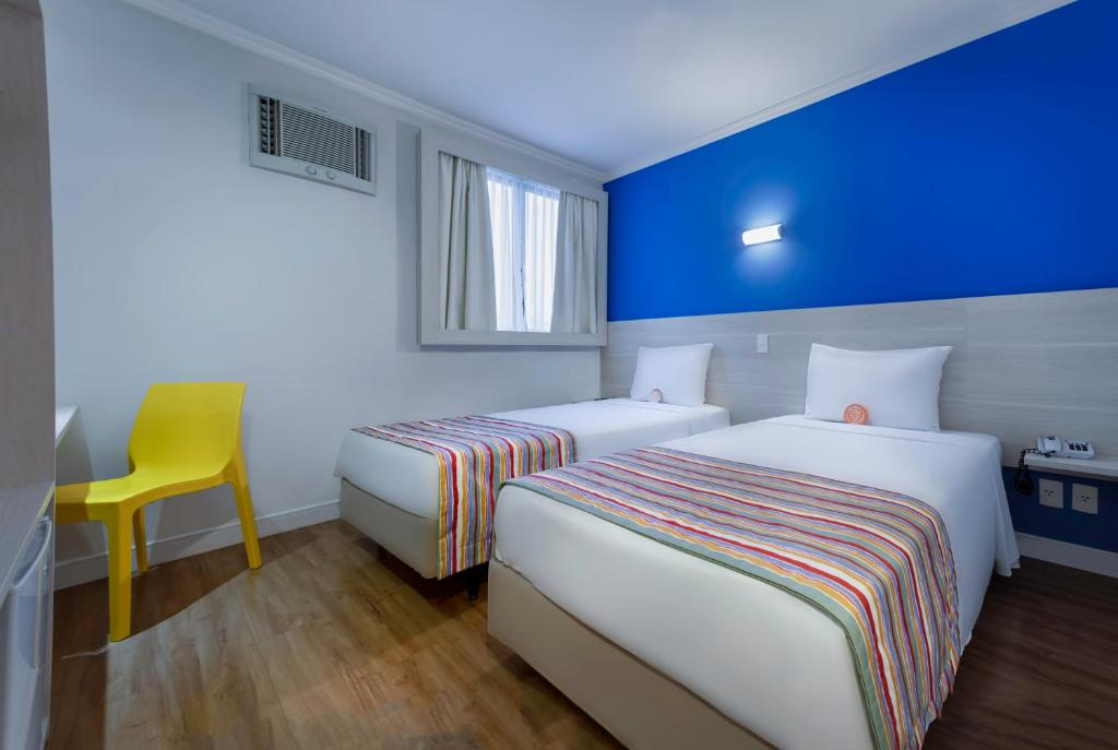 A bed or beds in a room at Go Inn São Paulo - Jaguaré