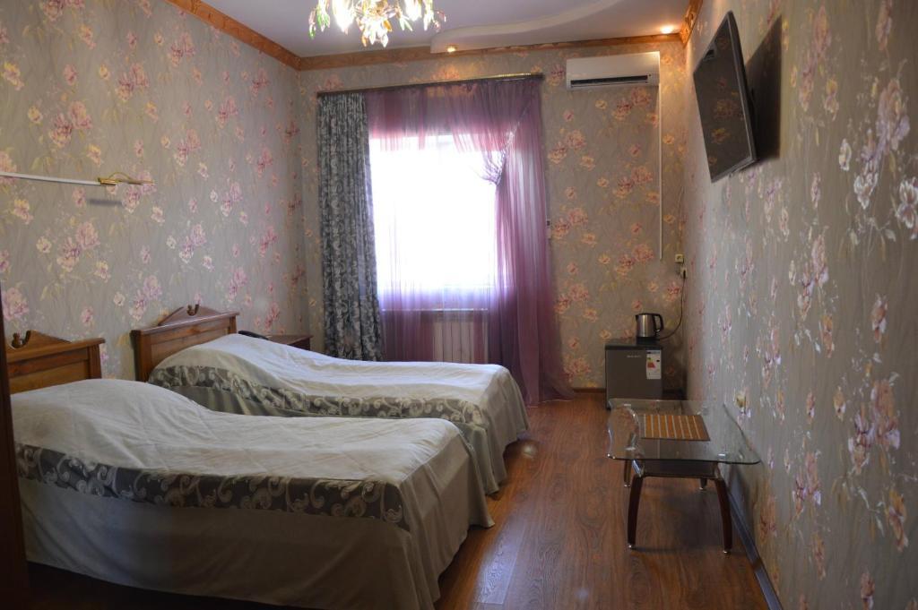 Кровать или кровати в номере Palazzo Kovrov