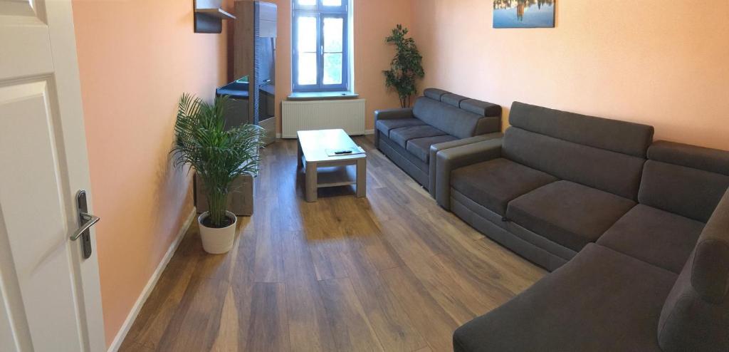 A seating area at Apartament Kleopatra