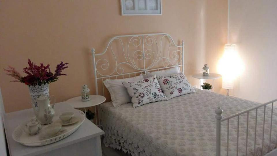 A bed or beds in a room at Salerno Inn B&B