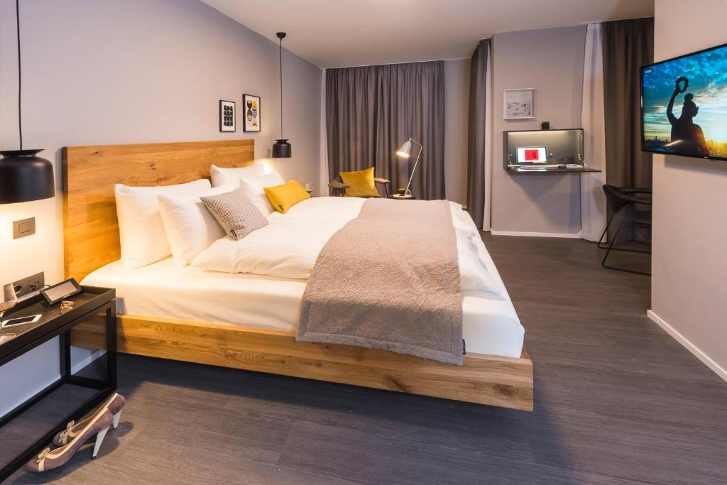 A bed or beds in a room at Timehouse Serviced Apartments