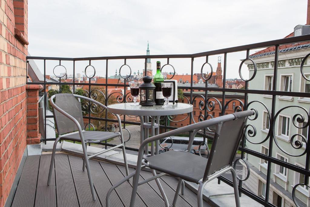 A balcony or terrace at Living Apartments Poznań