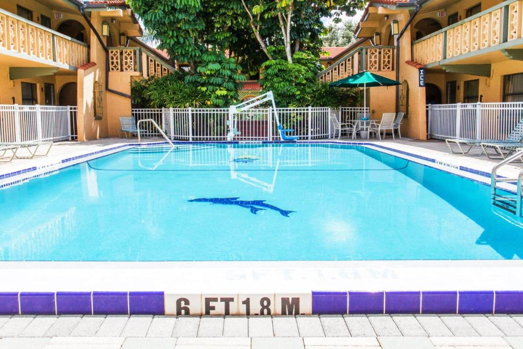 The swimming pool at or near Days Inn & Suites by Wyndham Altamonte Springs