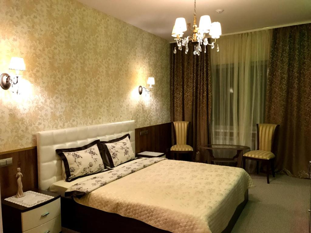 Кровать или кровати в номере Отель Комфорт